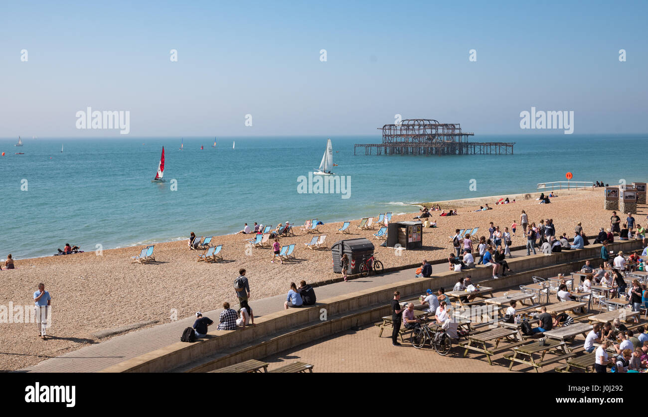 April, 9th 2017, Brighton, UK. People enjoy a sunny day at Brighton beach - Stock Image