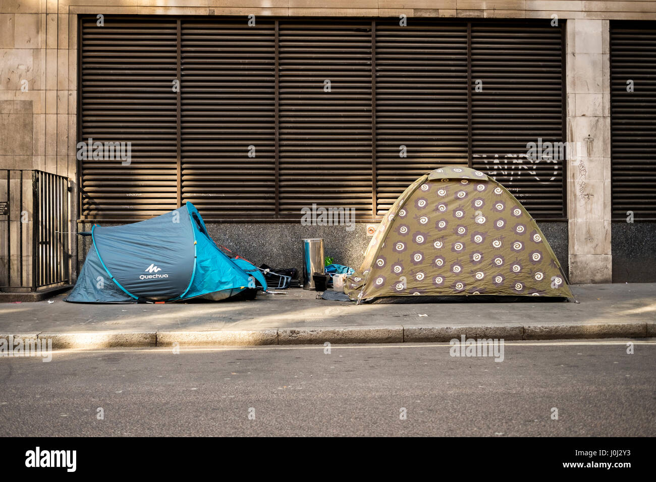Two homeless tents on Eastcastle Street, just metres from the bustling commercial Oxford Street in London's affluent Stock Photo