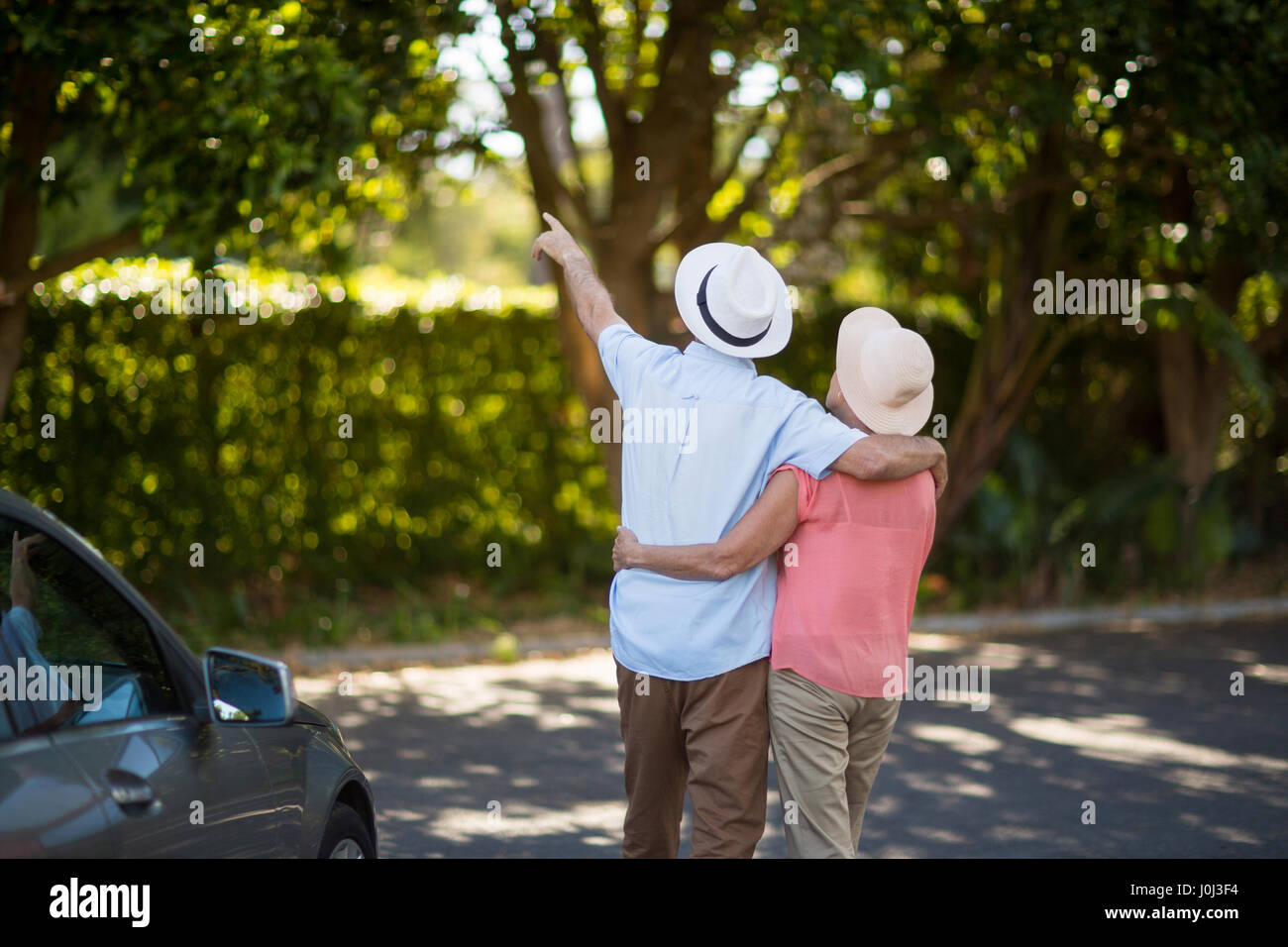 Rear view of senior couple spending leisure time - Stock Image
