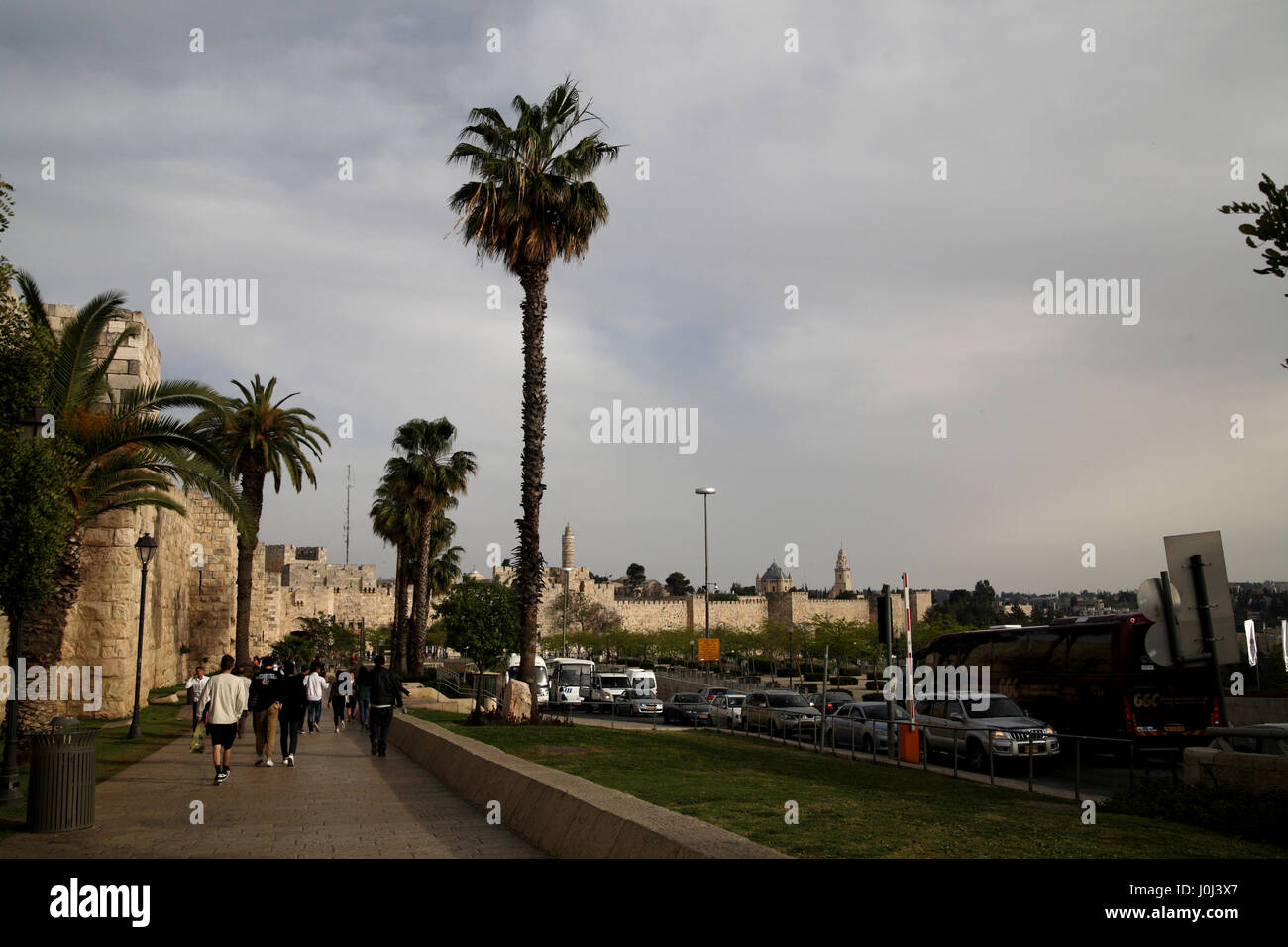 The western part of Old Jerusalem walls and Jaffa Road on a cloudy day, the Tower of David is in the center and - Stock Image