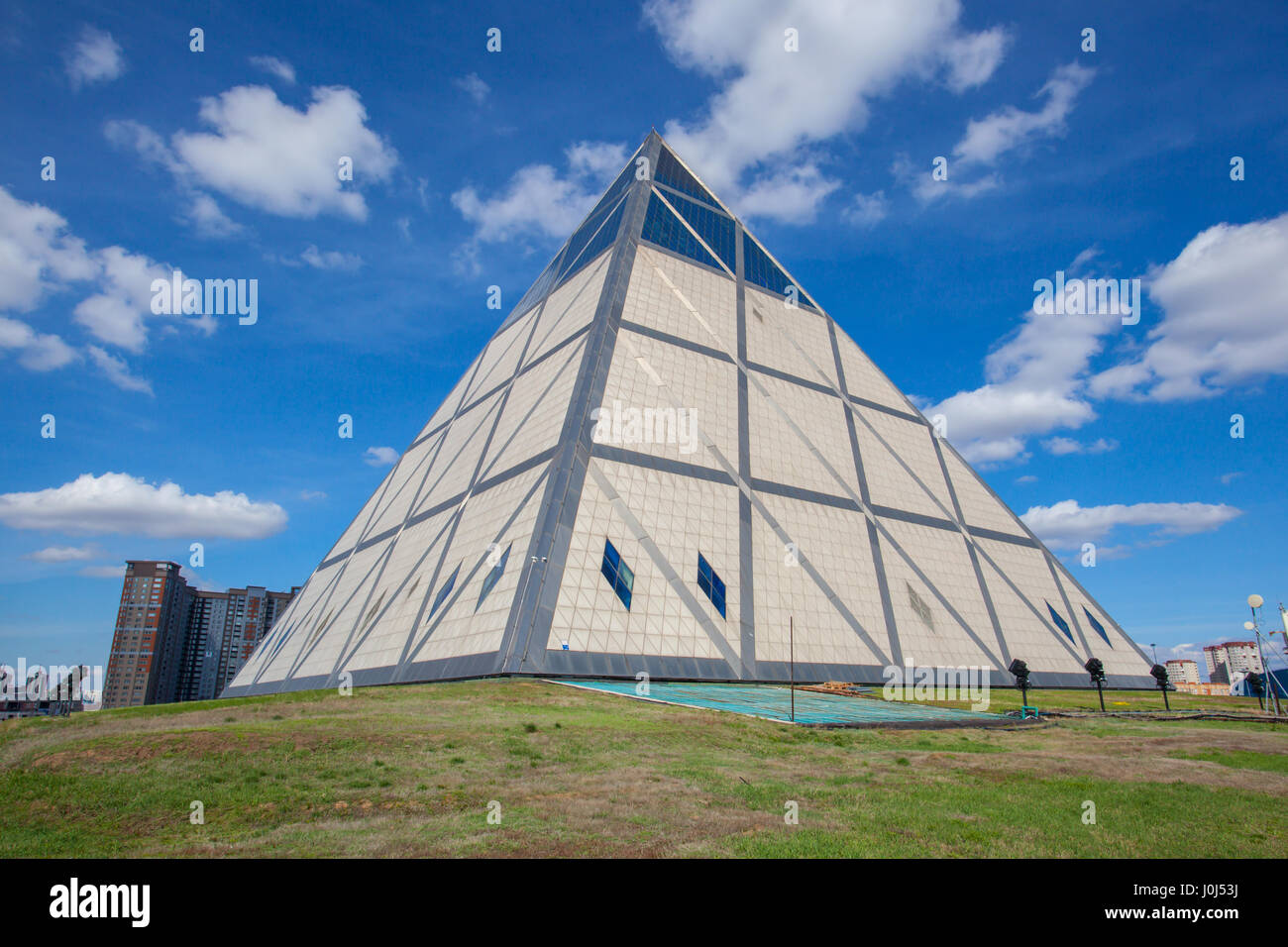 Pyramid - Palace of Peace and Accord. On a sunny day in Astana, capital of Kazakhstan - Stock Image