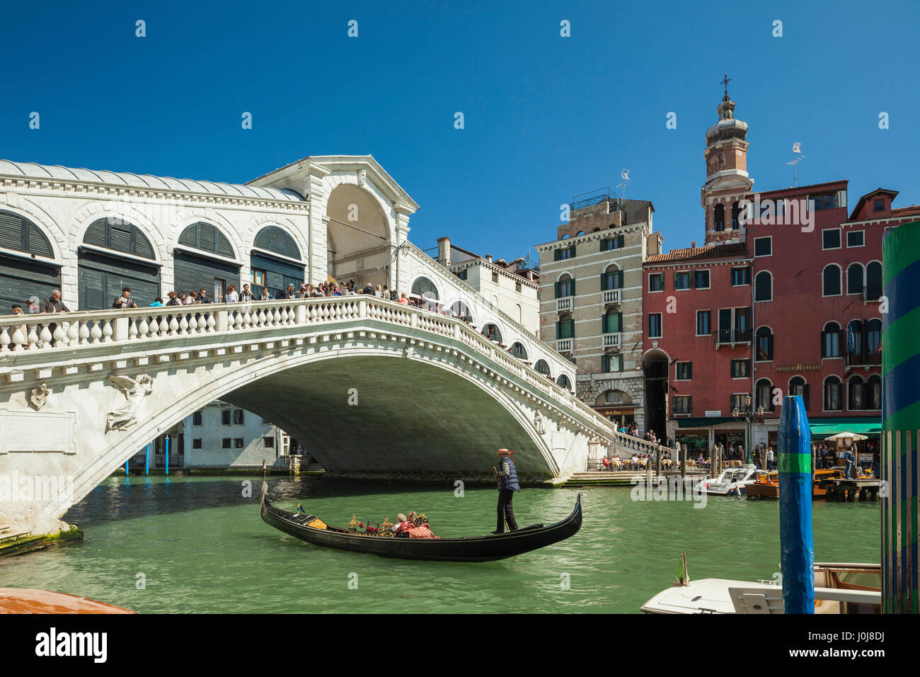 Spring afternoon at Rialto Bridge across Grand Canal, Venice, Italy. - Stock Image