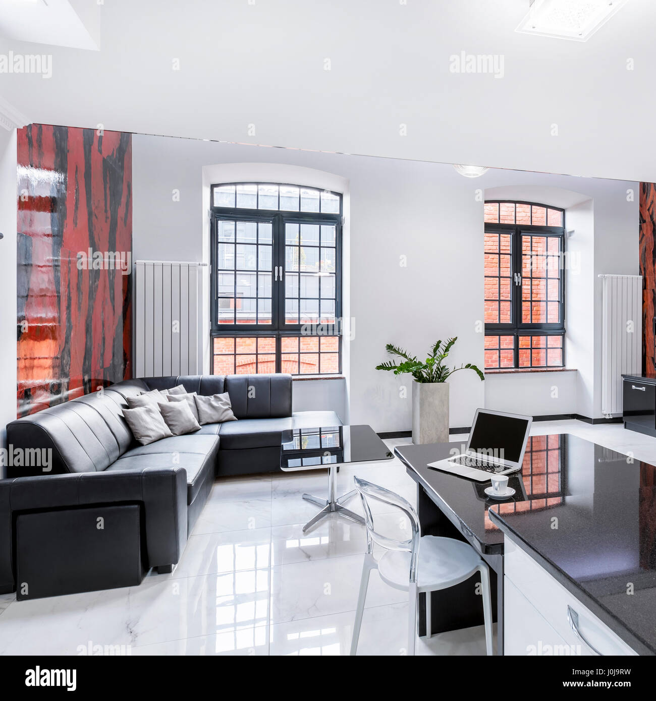 Modern designed apartment with open living room, desk and computer ...