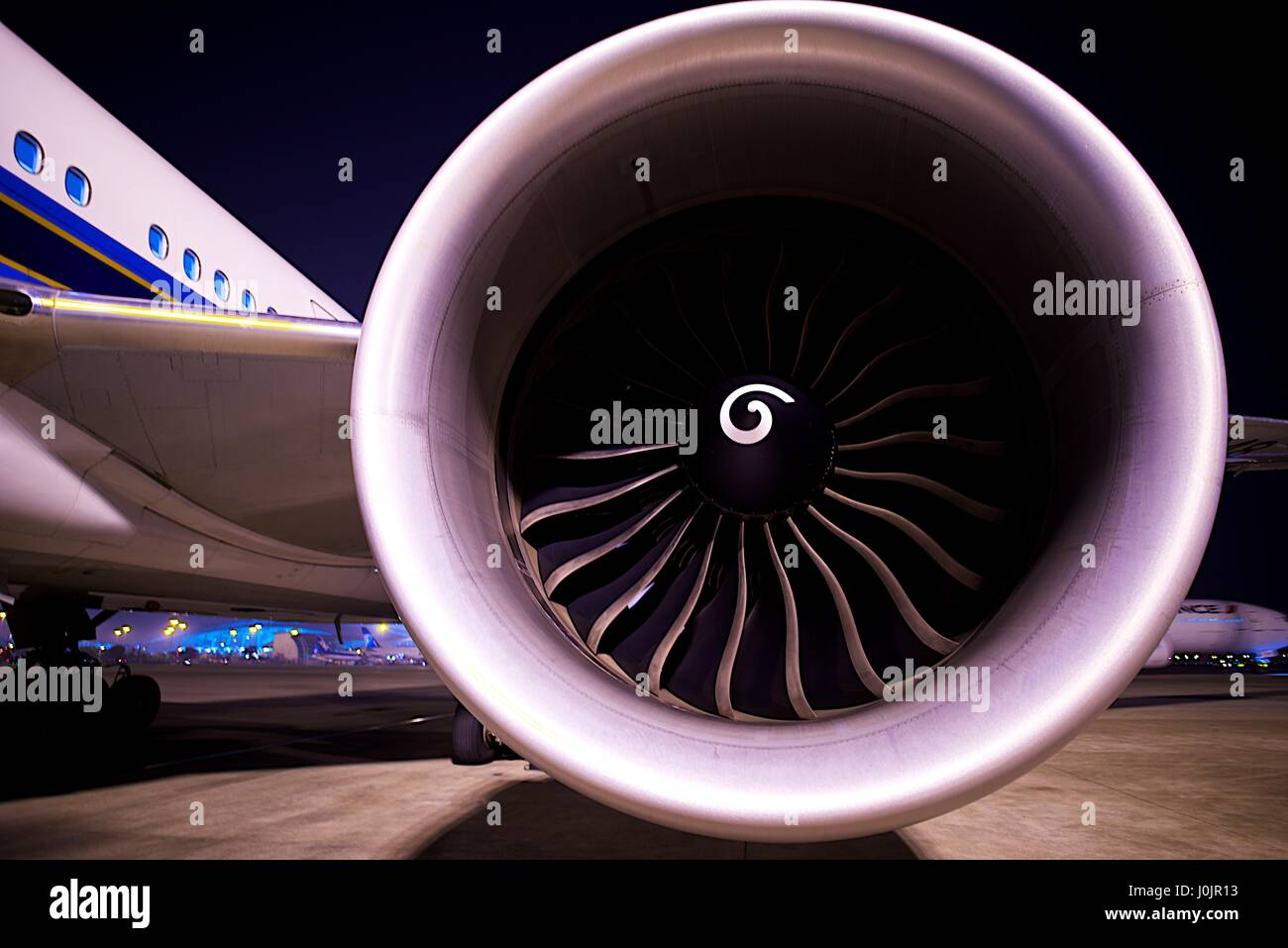 Direct view into a jet engine of a passenger plane preparing for take-off - Stock Image