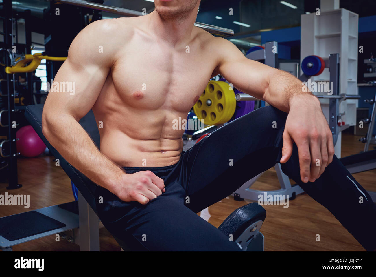 The athletic body of a man in gym - Stock Image