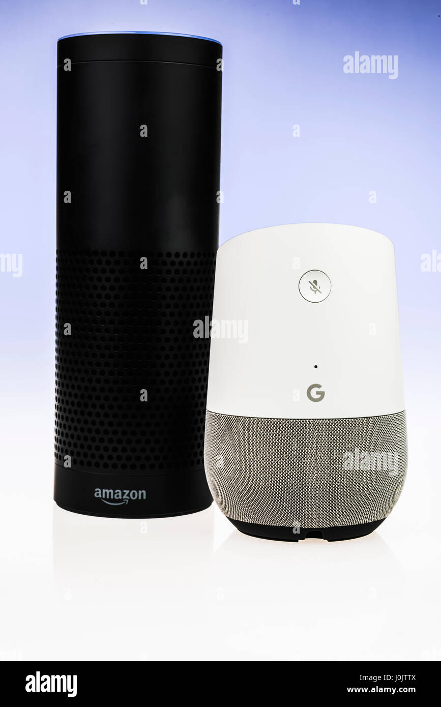 Google Home and Amazon Echo smart speakers.  Both offer voice activated personal assistants, music playing and home - Stock Image
