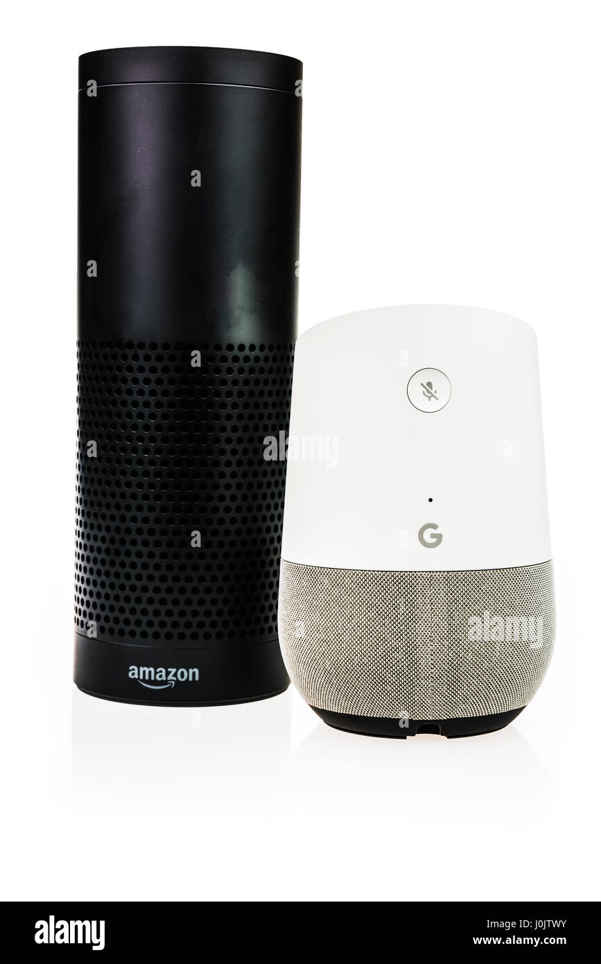 Google Home and Amazon Echo smart speakers.  Both offer voice activated personal assistants, music playing and home automation control. (white background) Stock Photo