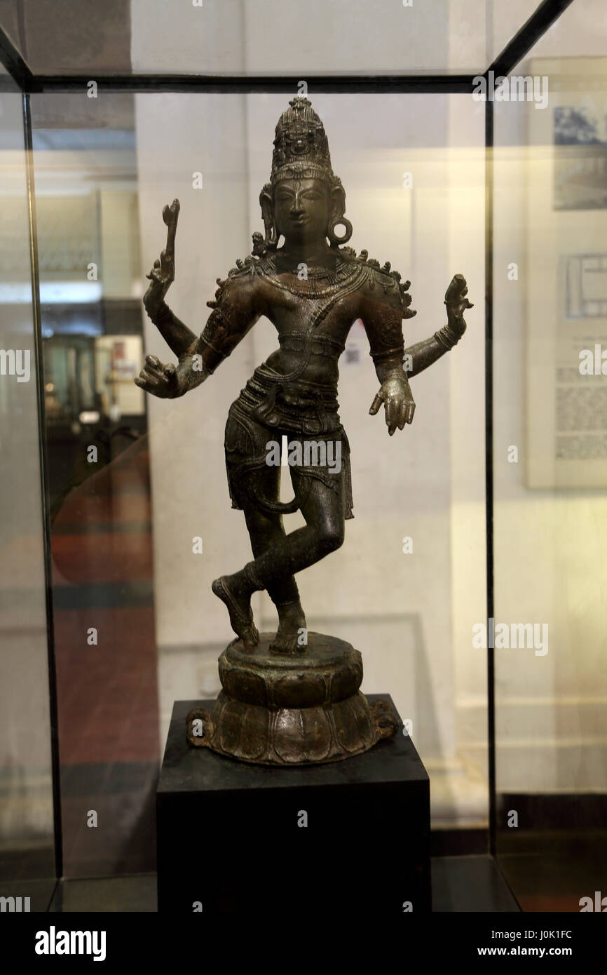 Colombo Sri Lanka National Museum 12th Century Statue of Hindu God Siva in relaxed posture after performing the - Stock Image