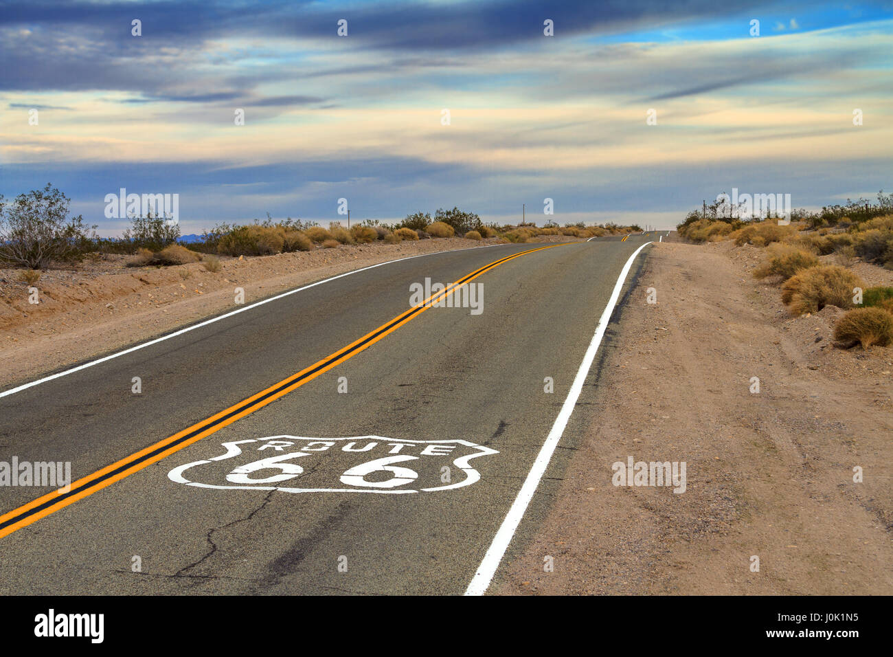 Route 66 road sign on the floor of the highway. - Stock Image