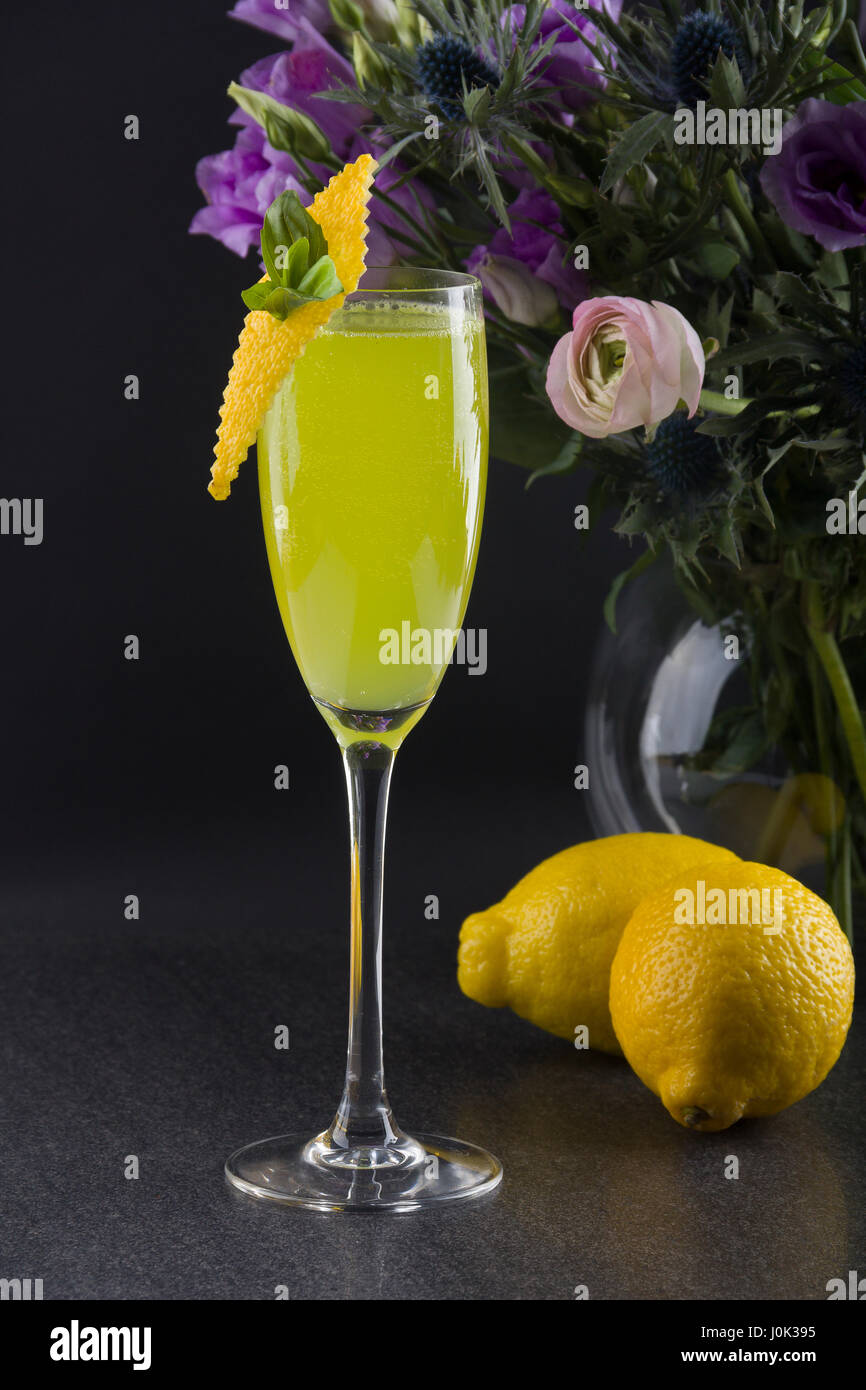 Fresh basil muddled and shaken with limoncello and lemon, charged with Prosecco - Stock Image
