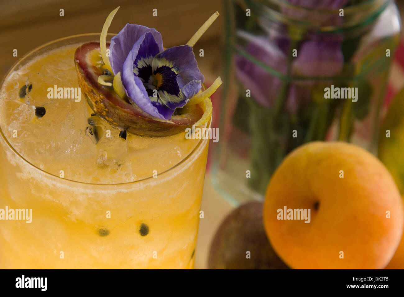Gin shaken with apricot brandy, apricot conserve, and squeezed passion fruit - Stock Image