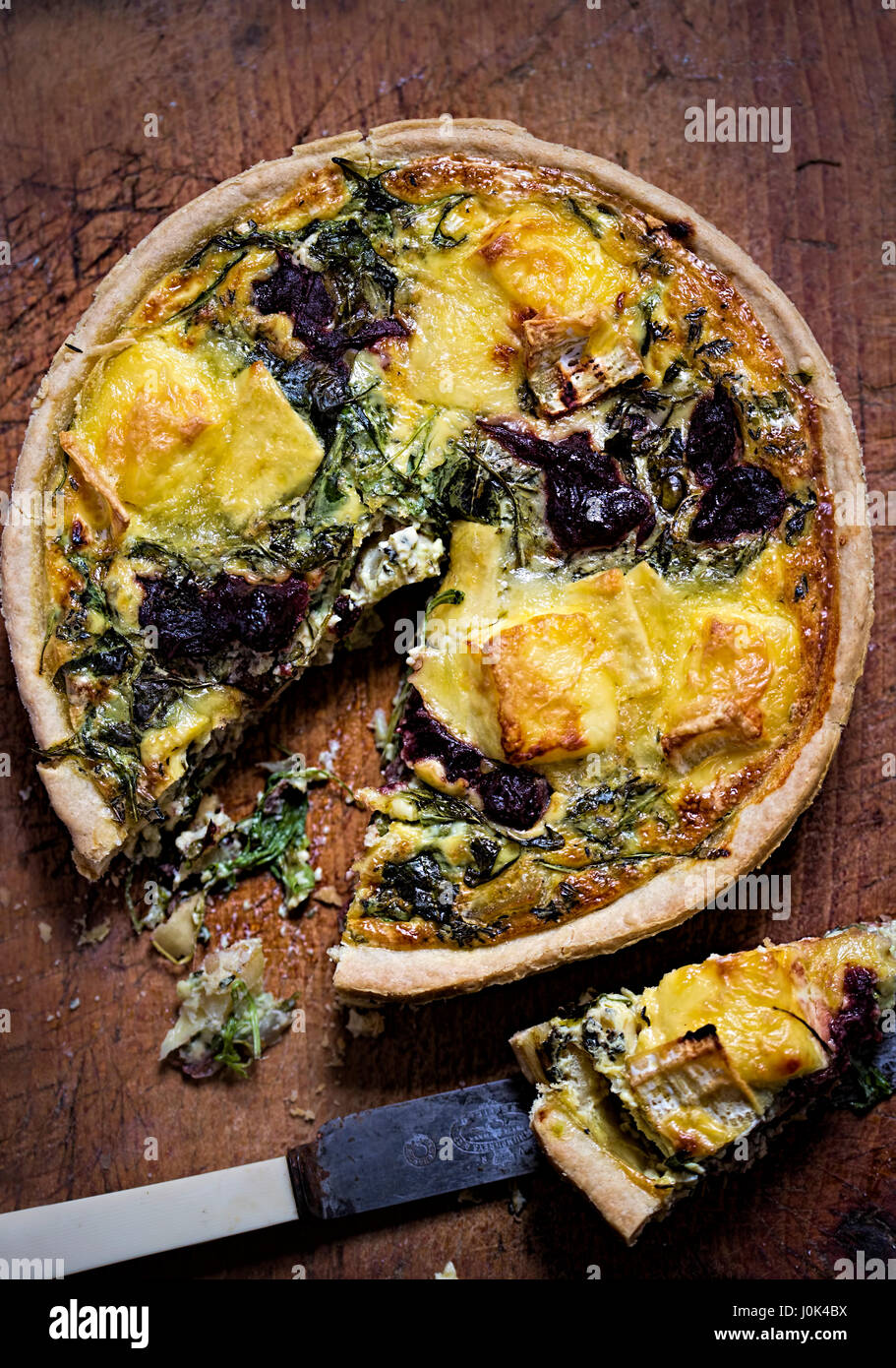 Festive brie, rocket leaves and cranberries quiche - Stock Image