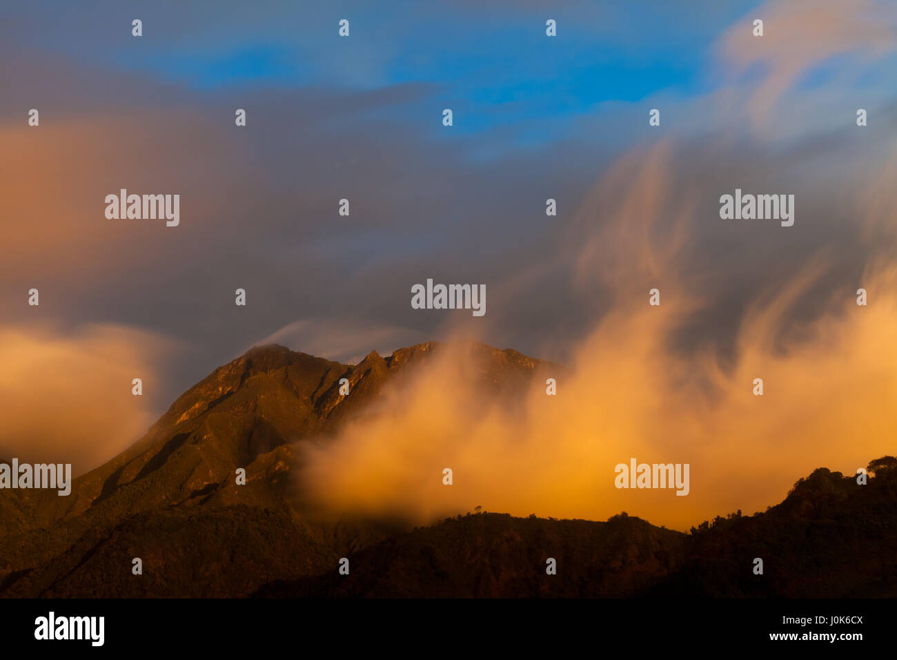 Colorful clouds at sunset in Volcan Baru National Park, Chiriqui province, Republic of Panama. - Stock Image