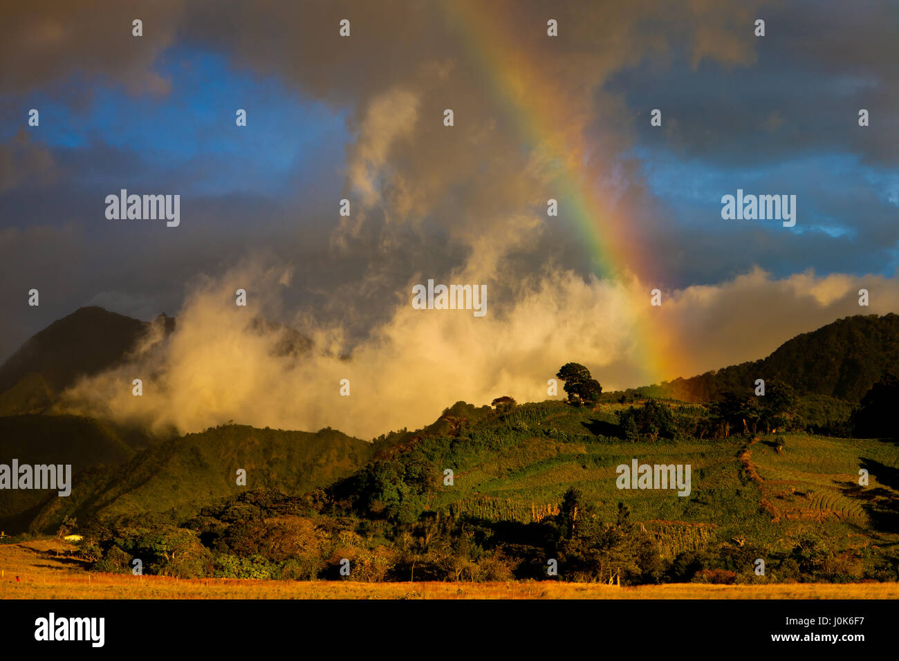 Rainbow at sunset in Volcan Baru National Park, Chiriqui province, Republic of Panama. - Stock Image
