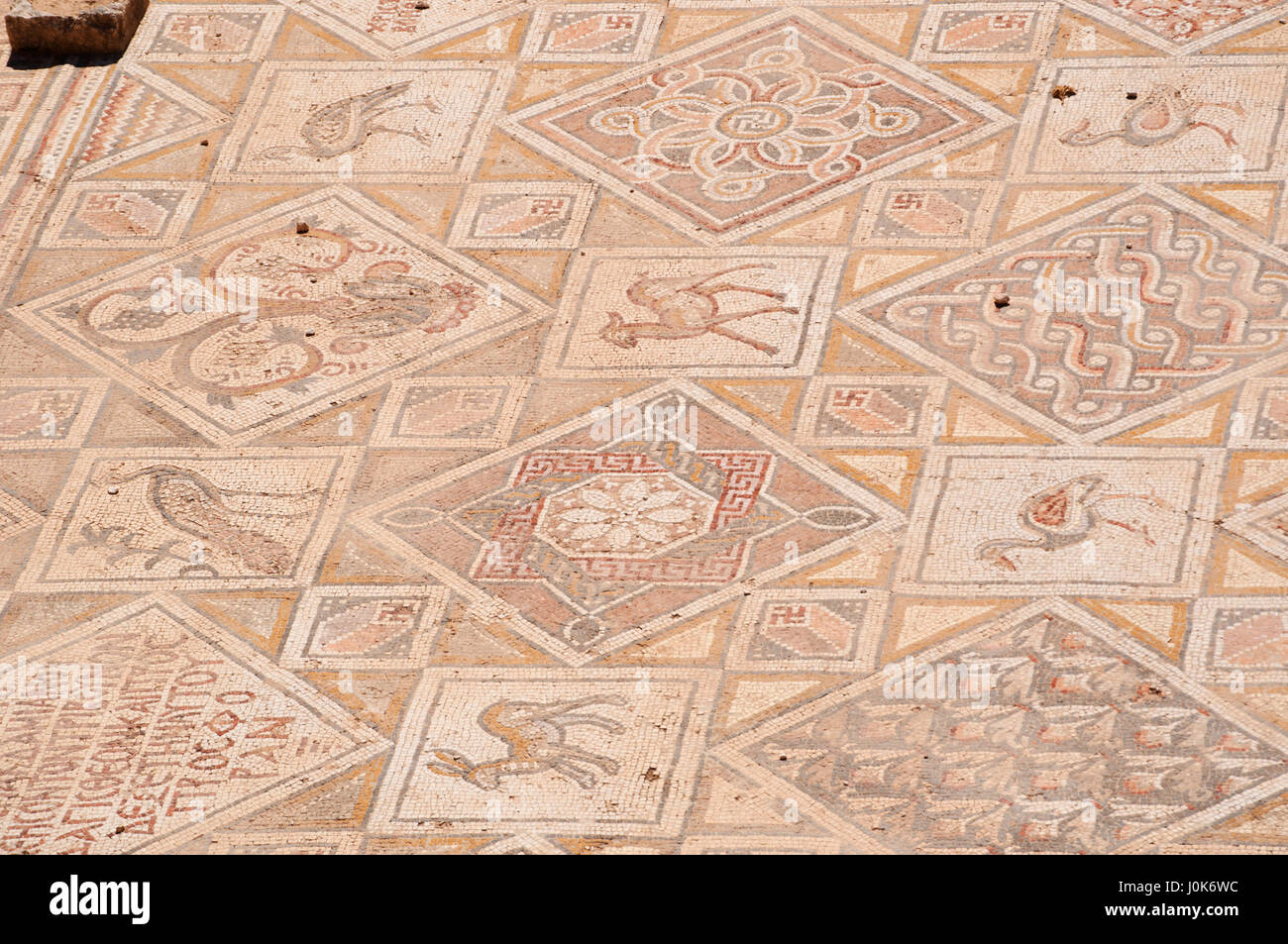 Details of the mosaics of the Byzantine churches found in the archaeological city of Jerash, one of the world's - Stock Image