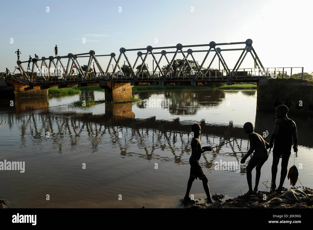 SOUTH SUDAN Lakes state, Rumbek, boys catching fish at Bamam bridge, which was destroyed during the war between - Stock Image