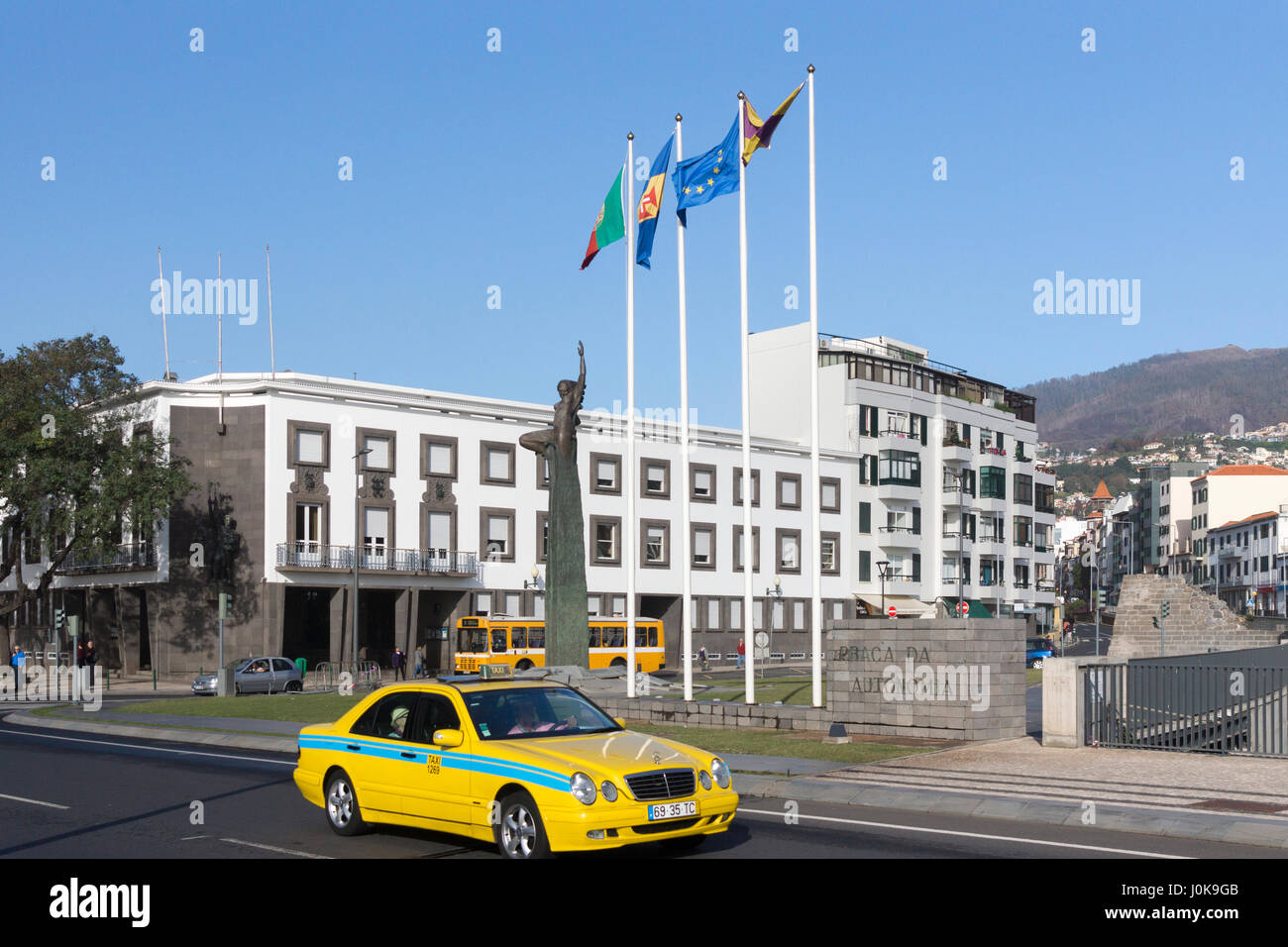 A typical Madeiran taxi passing in front og Praça da Autonomia (Autonomy Square) in Funchal - Stock Image