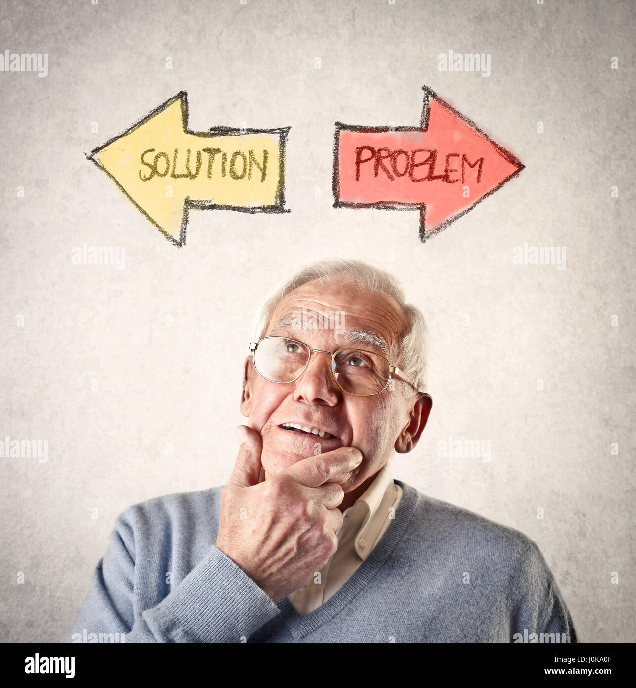 Old man thinking about problem solving - Stock Image