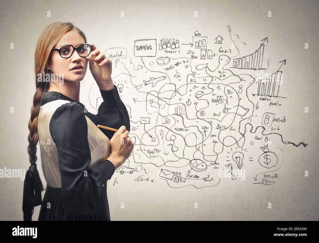 Blond woman making a business plan - Stock Image