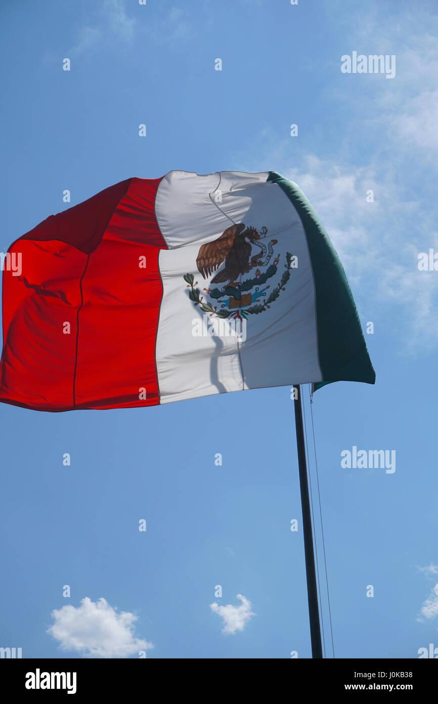 Mexican flag waving over Mexico City, Mexico - Stock Image