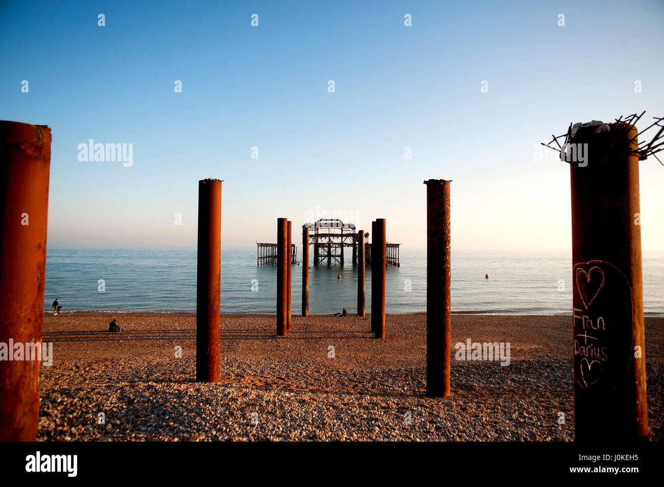 Brighton and Hove's West Pier is a famous landmark on the south coast of England, now a burnt-out rusting skeleton - Stock Image