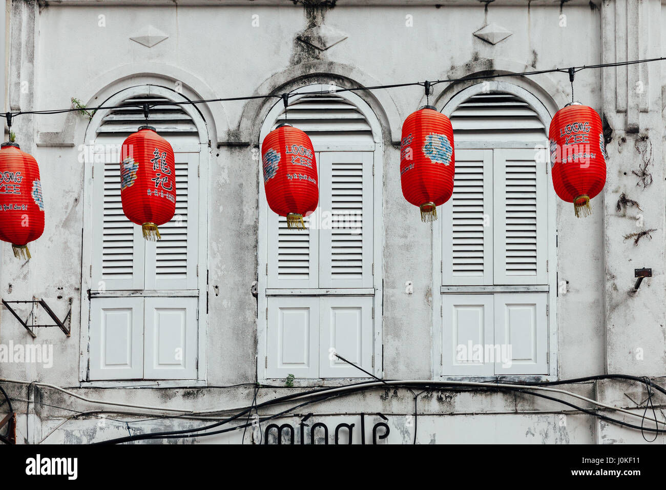 Kuala Lumpur, Malaysia - September 14, 2016: Facade of the historical building decorated with red chinese lanterns - Stock Image