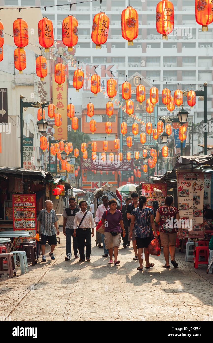 Kuala Lumpur, Malaysia - March 17, 2016: People walking through Petaling Street in Chinatown during the morning - Stock Image