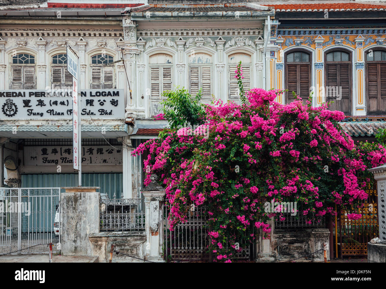 George Town,  Malaysia - March 22, 2016: Facade of the old shophouse building in UNESCO Heritage buffer zone in Stock Photo