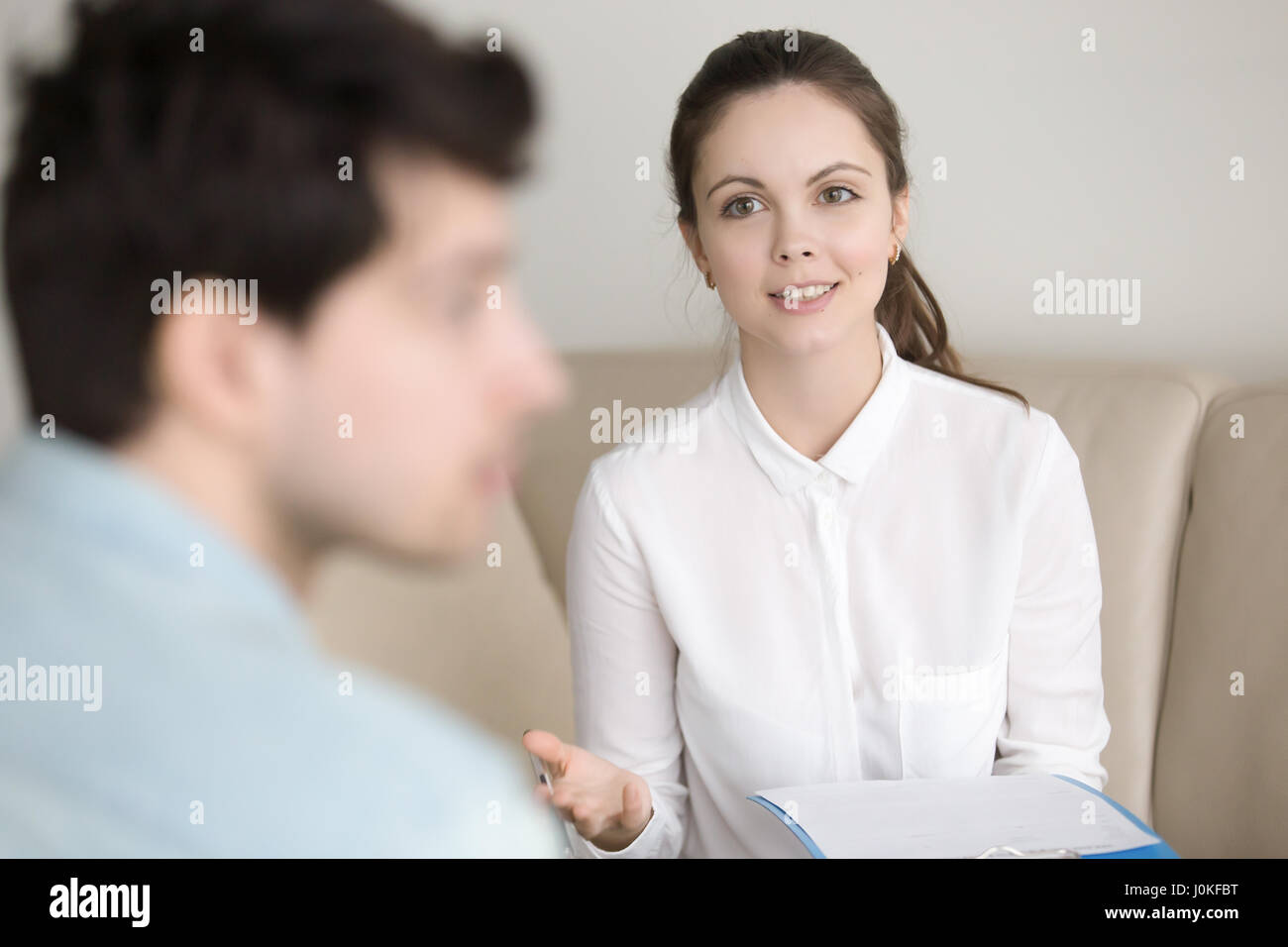 Psychological therapy, female psychotherapist cheering up depres - Stock Image