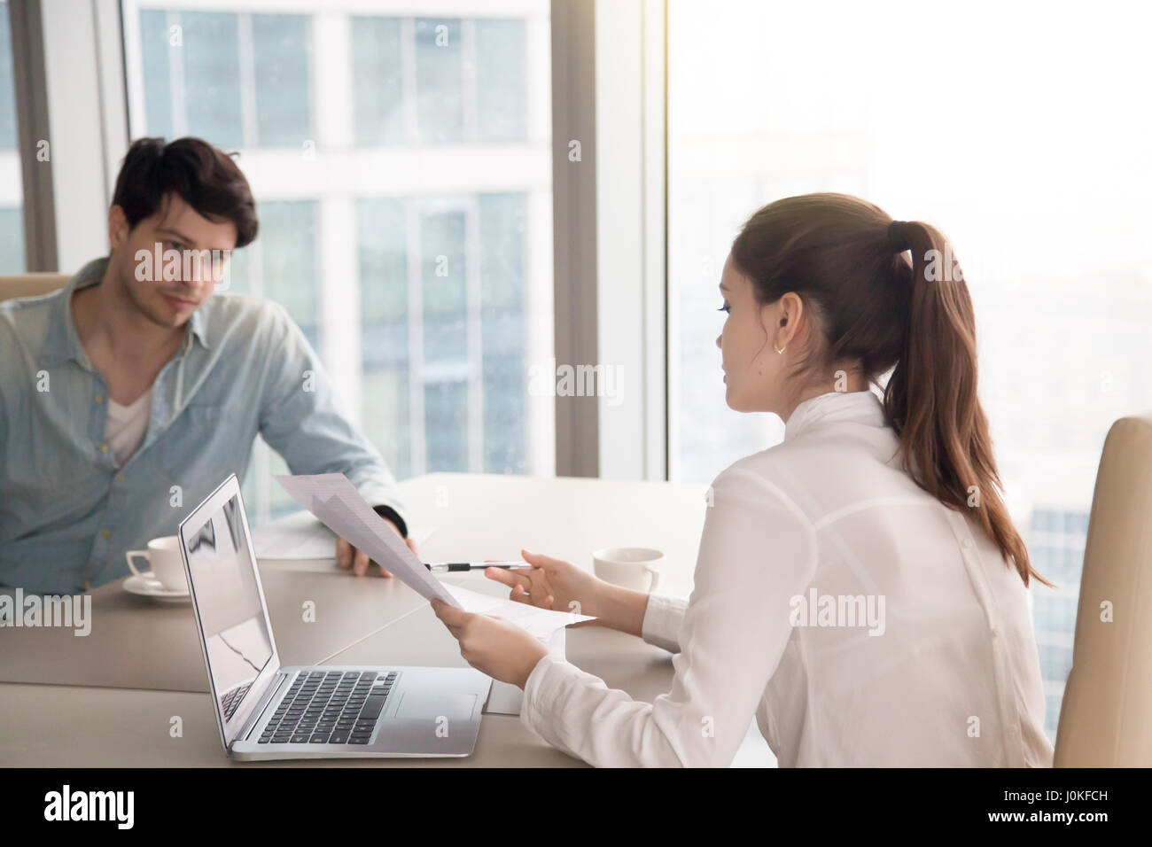 Business meeting, man and woman working on project at office - Stock Image