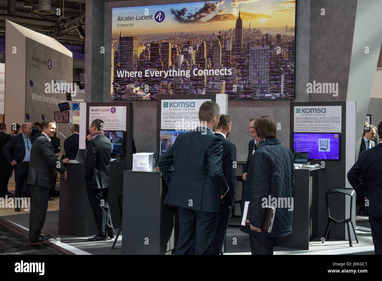 Hannover, Germany - March 22, 2017: Booth of the company Alcatel Lucent with business men at CeBIT 2017. CeBIT is - Stock Image