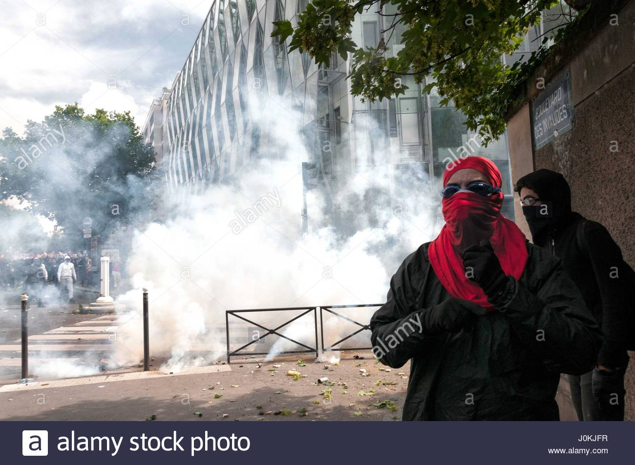 PARIS - DECEMBER 2016—Demonstrators use tear gas during a protest. Train drivers on strike to reject reform relaxing - Stock Image