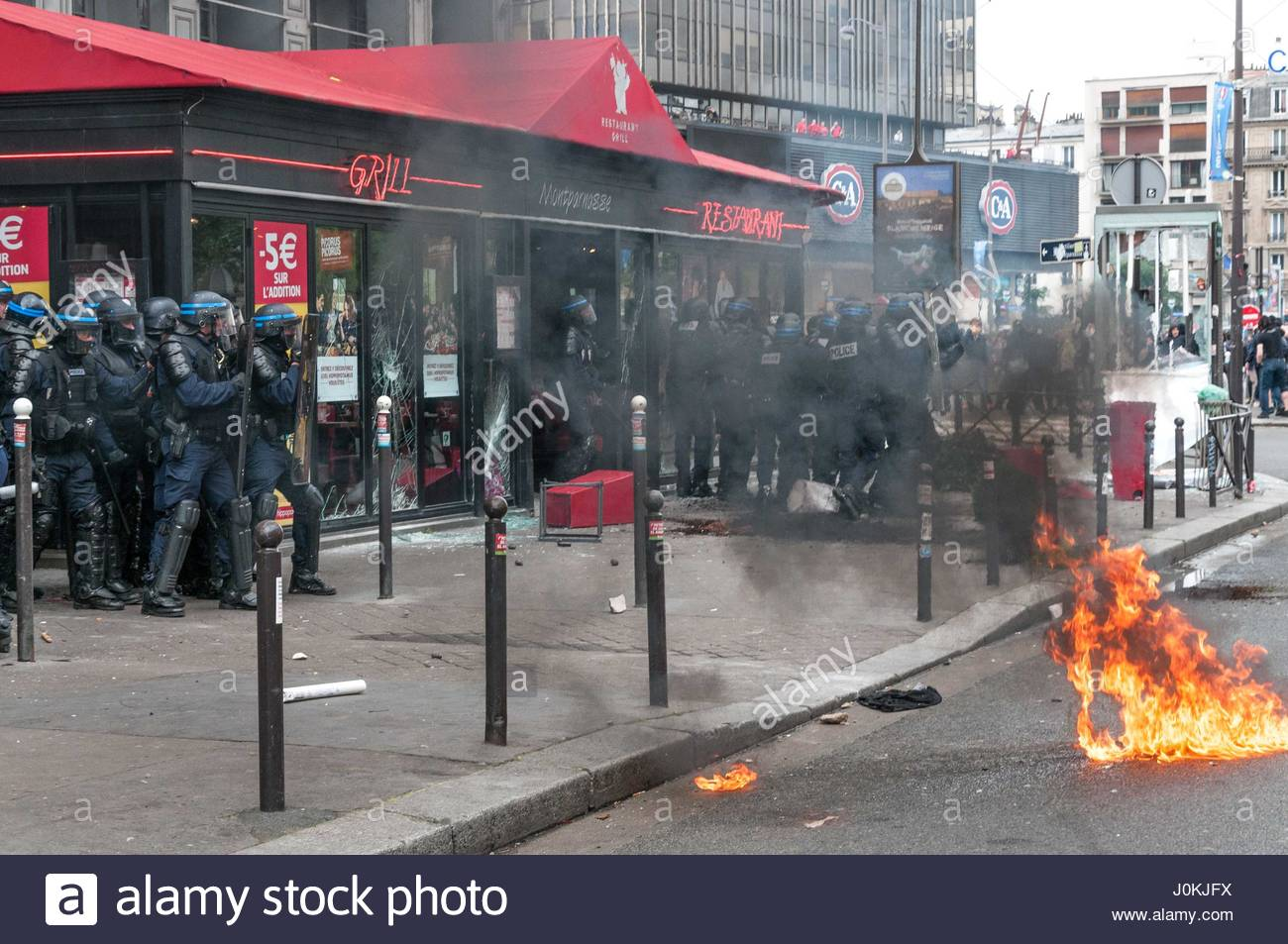 PARIS-DECEMBER 2016—Demonstrators use tear gas during a protest. Train drivers on strike to reject reform relaxing - Stock Image