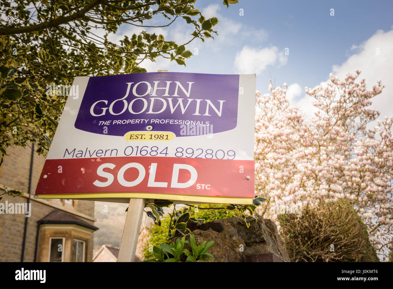 Sold sign outside a property in great Malvern, Worcersteshire, UK Britain estate agent - Stock Image