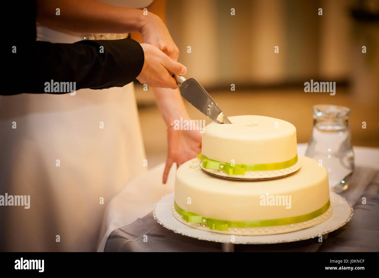 Beautiful wedding cake detail. Traditional first slice cutting by ...