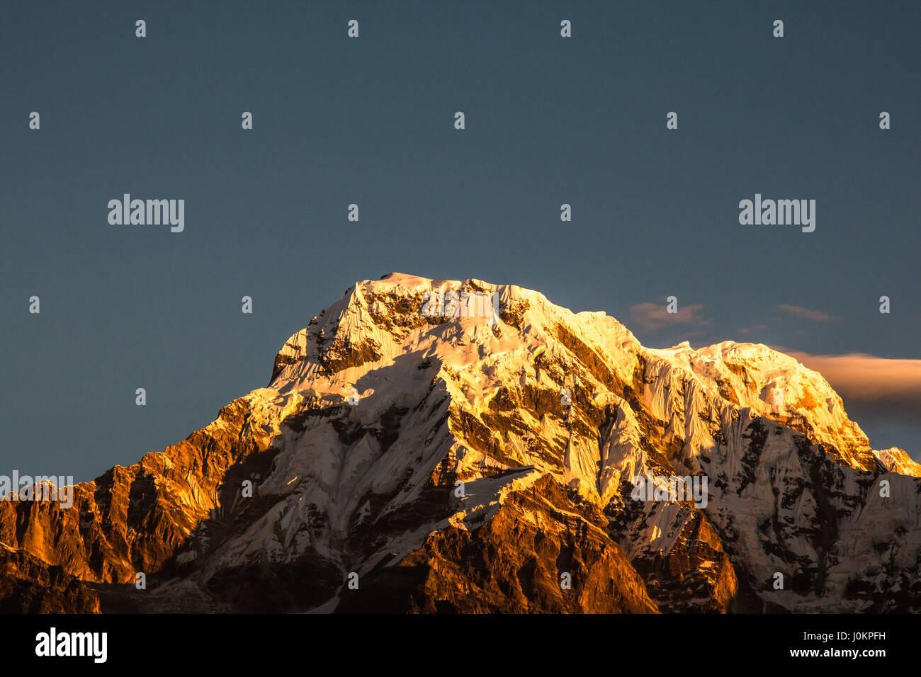 The beautiful sunset glow on Himalayan mountains near Annapurna I and II - Stock Image
