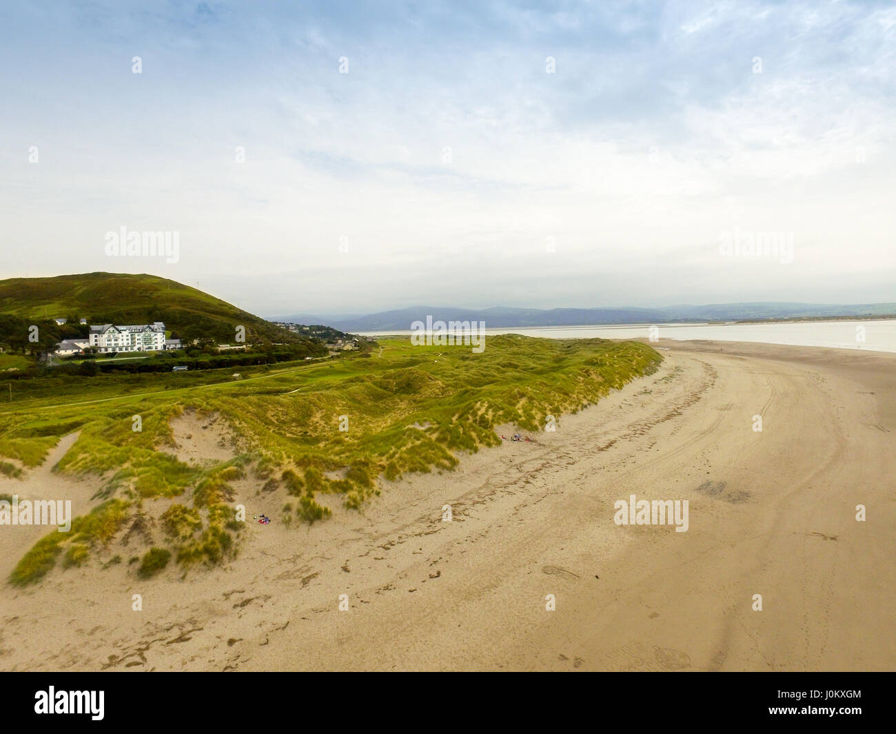 Aerial photograph of Aberdovey beach, sand dunes, Aberdovey Golf Club and Trefeddian Hotel. - Stock Image