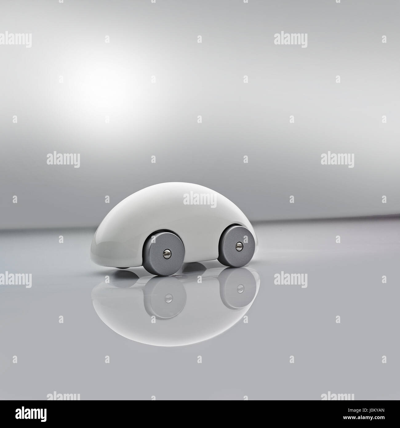 White Model Car on grey background - Stock Image