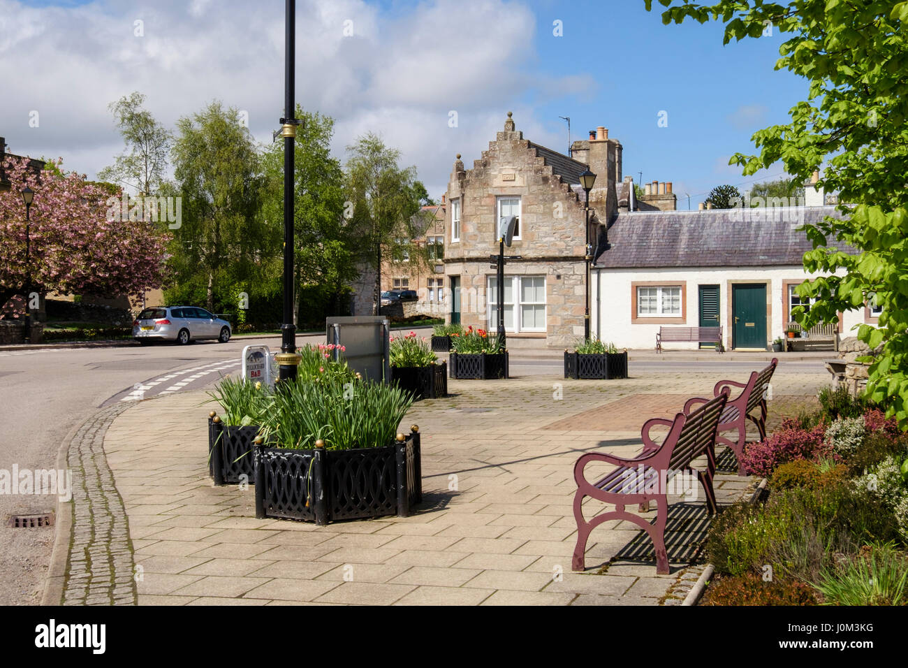 Bench seats in centre of historic small Scottish town. Royal Burgh of Dornoch, Sutherland, Highland, Scotland, UK, - Stock Image