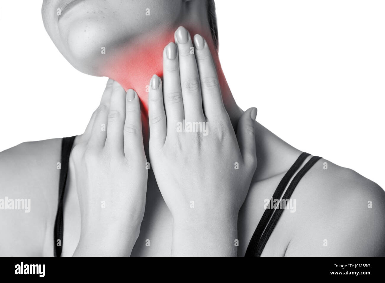 Closeup view of a young woman with pain on neck or thyroid gland.  isolated on white background. Black and white - Stock Image