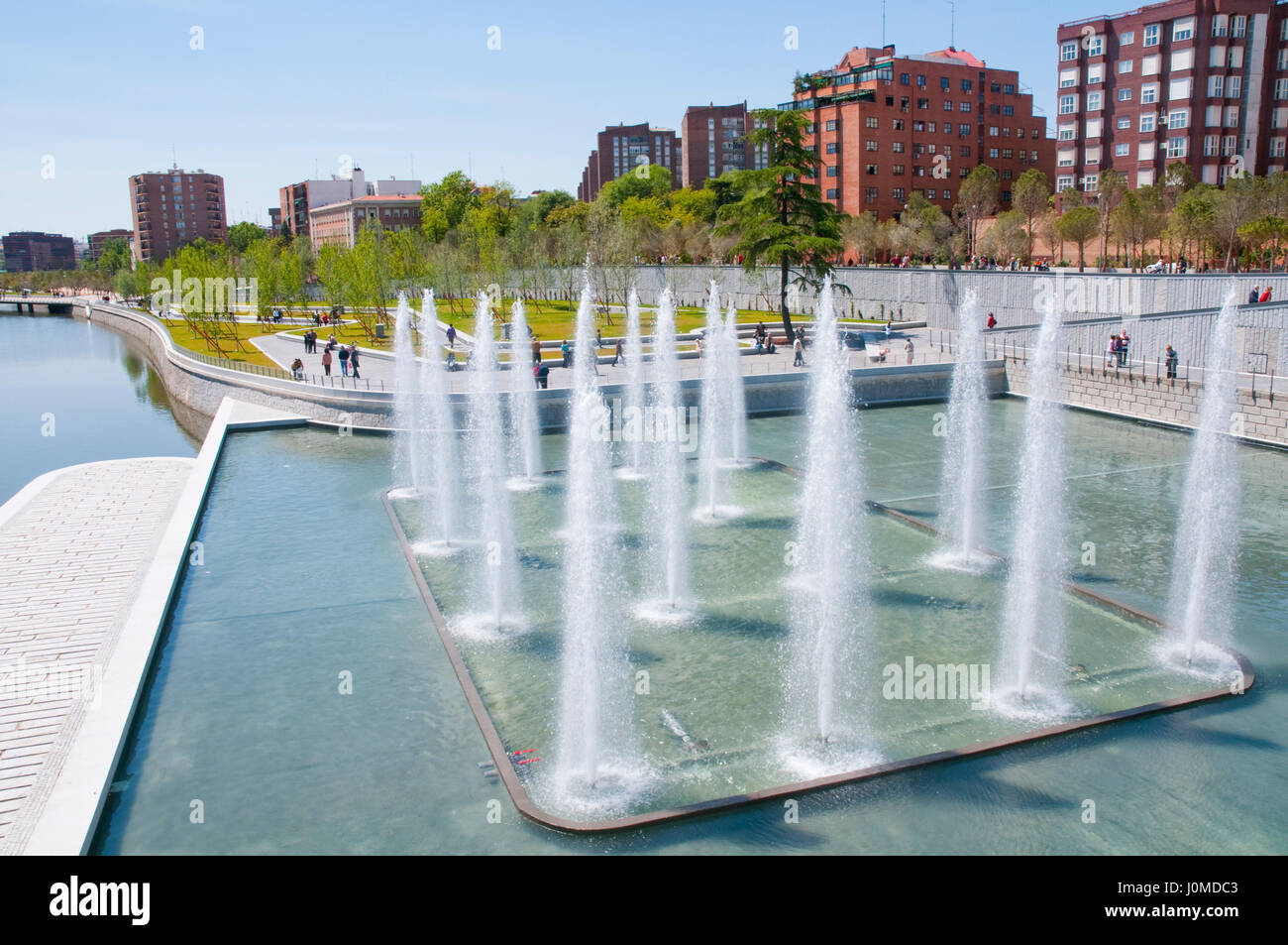 Fountain and pond. Madrid Rio park, Madrid, Spain. - Stock Image