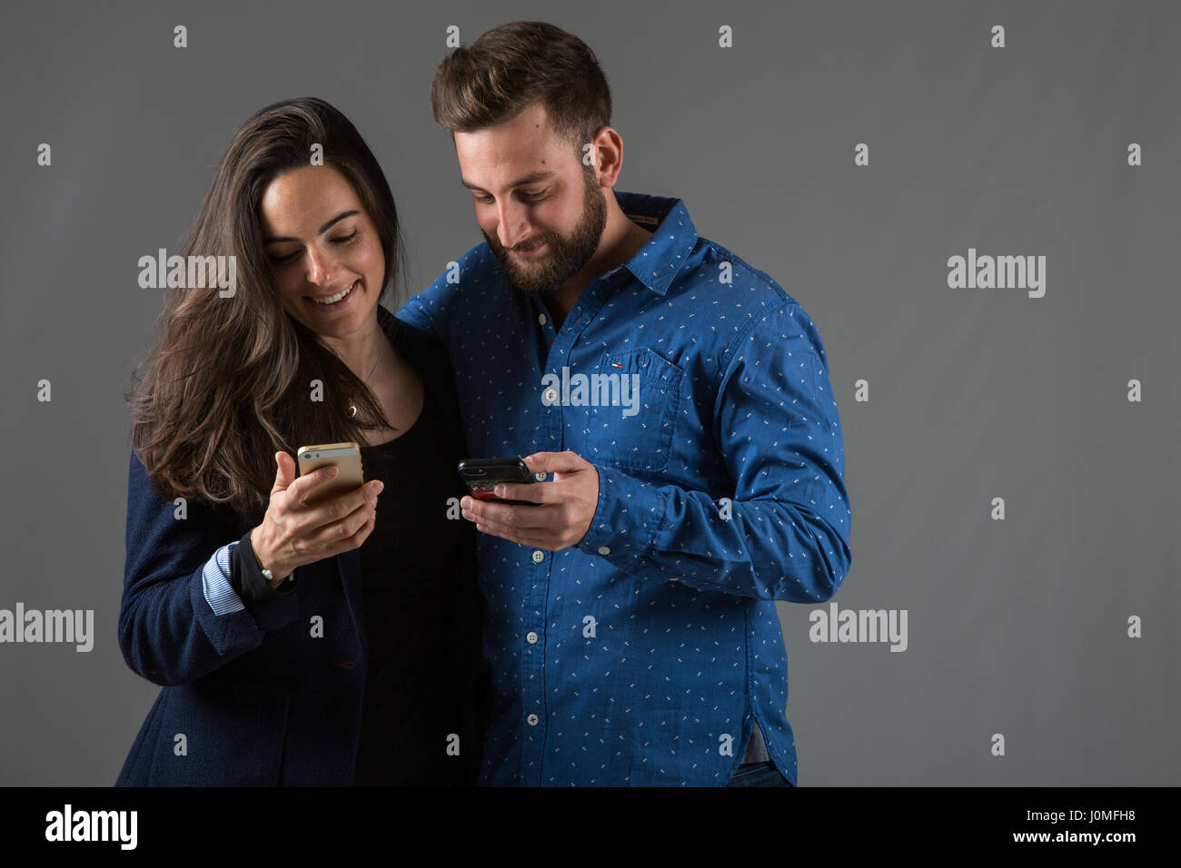 Young couple with tech - Stock Image