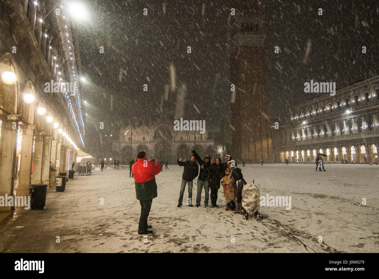 People take pictures during an heavy snow fall in Venice. - Stock Image