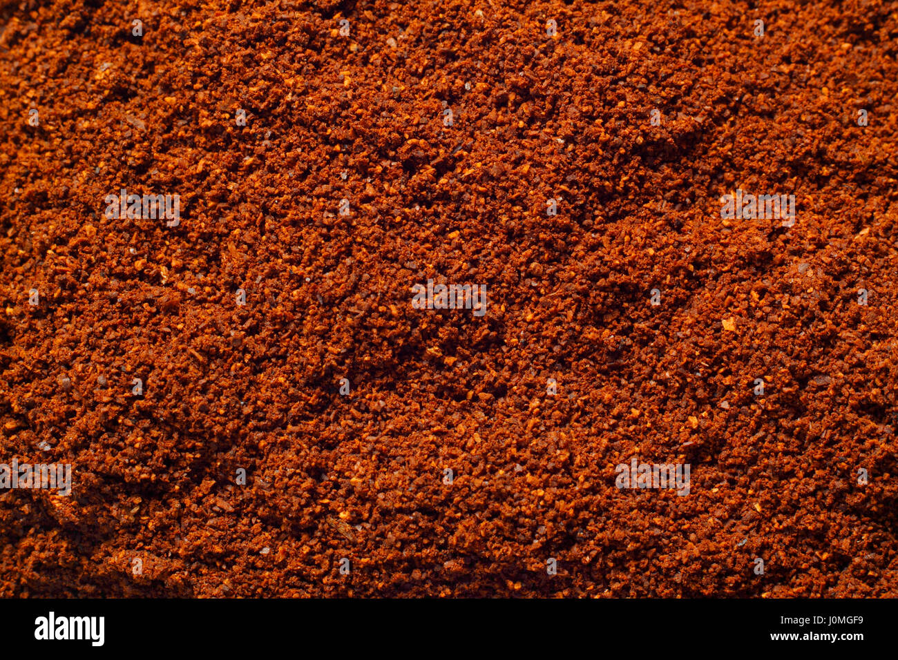 Ground coffee texture close-up. Full frame, top view. - Stock Image