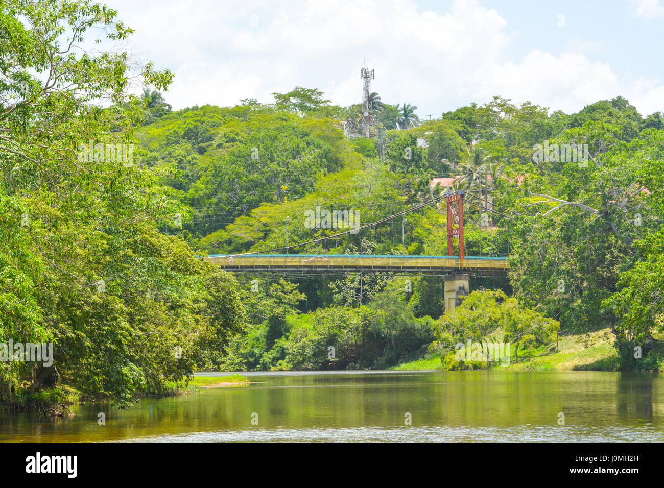 The iconic Hawksworth Suspension Bridge over Macal River in San Ignacio, Belize. - Stock Image