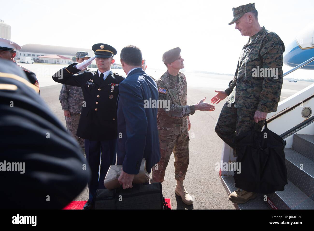 Joseph F Dunford, the chairman of the Joint Chiefs of Staff, is greeted by Joseph Votel, commander of US Central - Stock Image