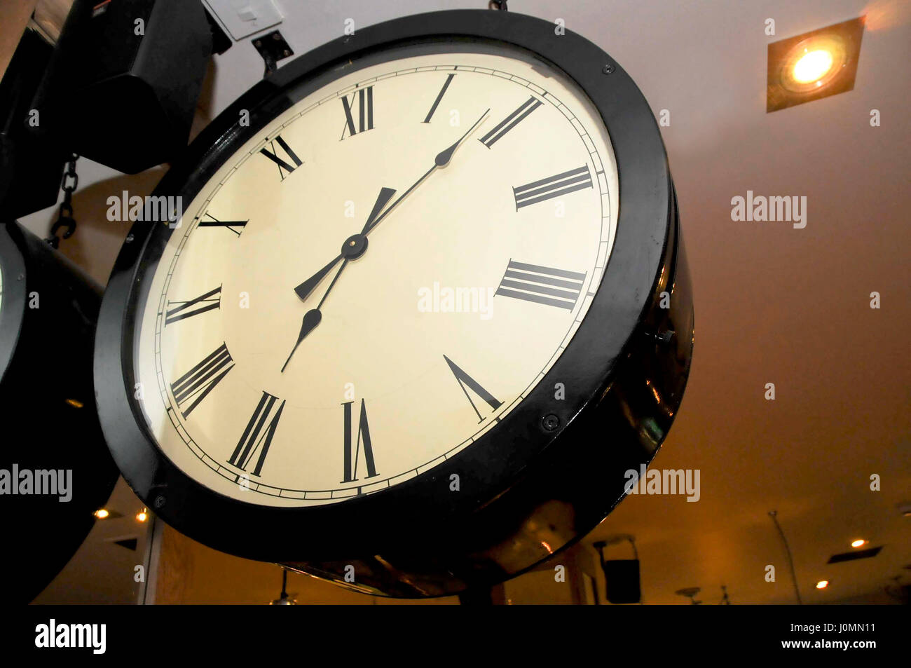 Clock with Roman numerals Black - Stock Image