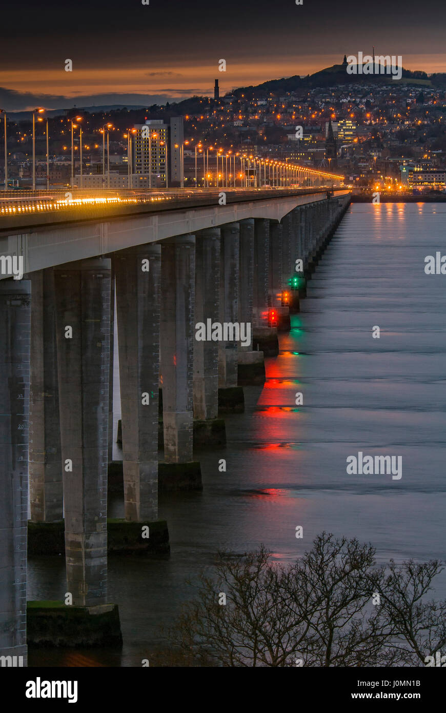 The Tay road bridge into Dundee at night. - Stock Image