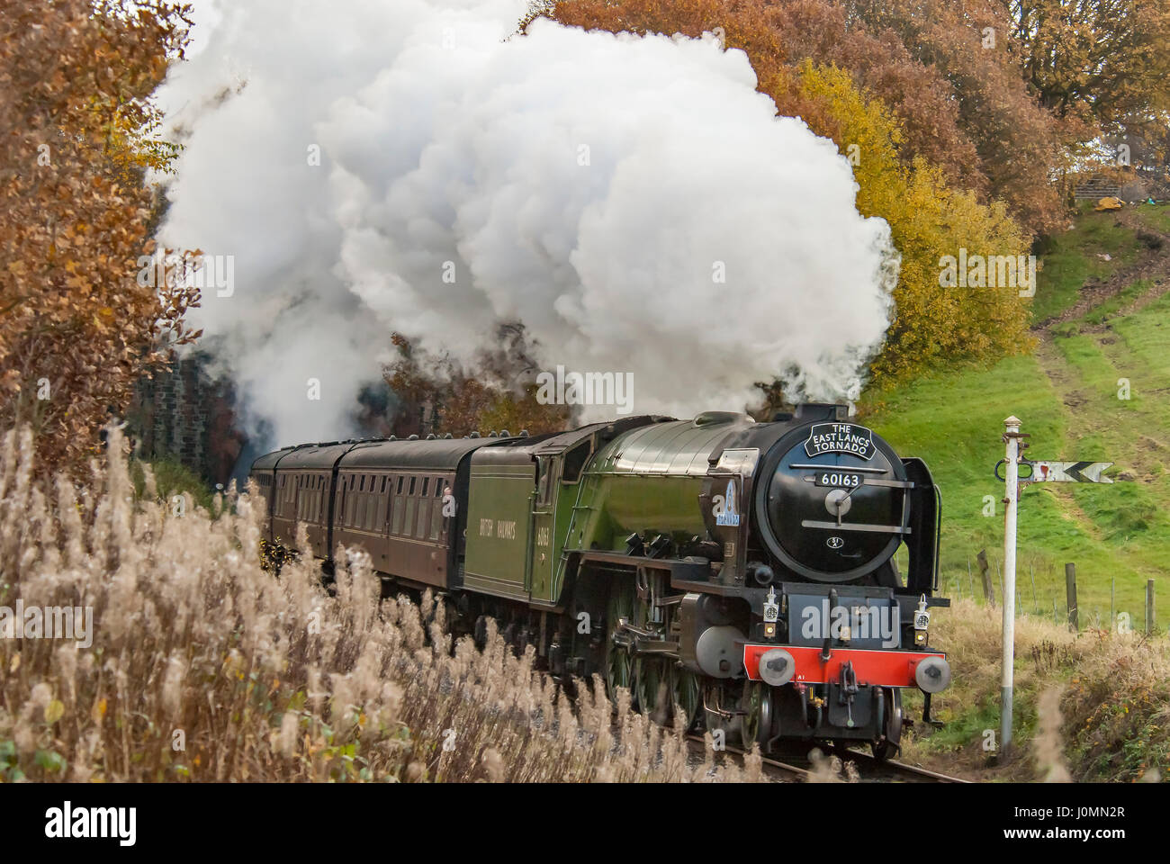 Tornado steam loco engine at Nuttall tunnel on the ELR East Lancs Railway. Lancashire Stock Photo