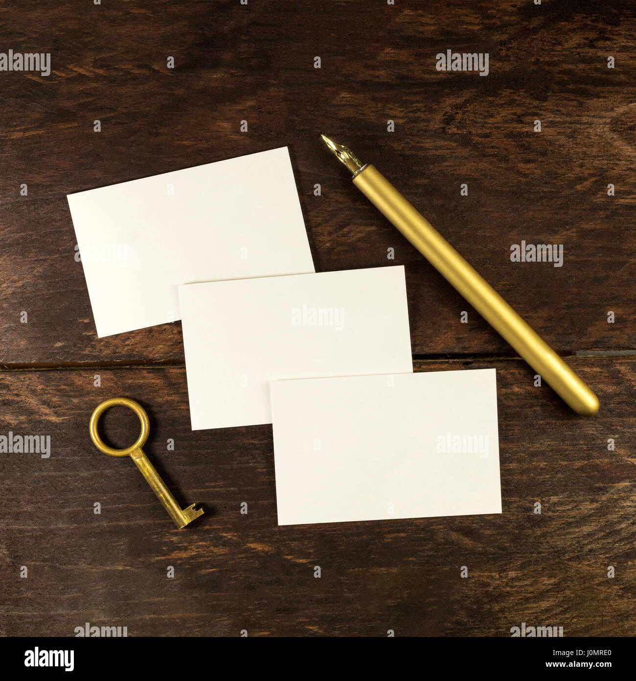 An overhead photo of blank white thick cardboard business cards on a ...